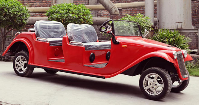 Side view of electric car in red, vintage car made in India
